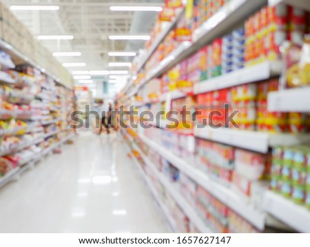 Perspective view, Abstract concept blurred background, Customer shopping consumer good on shelves between corridor with clear light in convenience supermarket and minimart Royalty-Free Stock Photo #1657627147