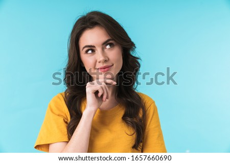 Image of a dreaming pleased young pretty woman posing isolated over blue wall background. #1657660690