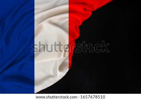 color national flag of modern state of France folded in soft folds on black blank, concept of tourism, economy, politics, emigration #1657678510