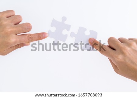 People hand connect two couple puzzle pieces. #1657708093