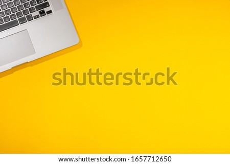 Flat lay out. Computer on yellow background. Business concept idea. Copy space. #1657712650