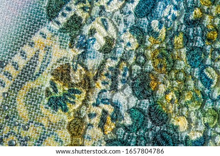 background texture; pattern. Cloth with glued lace stripes. Multicolored lace with sparkles; cording and metallic embroidery. Beautiful traditional lace for design #1657804786