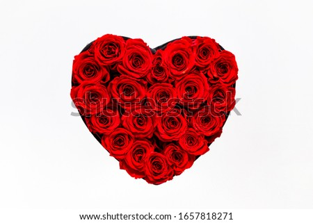 Red roses in a elegant box in the form of a heart on a white background. Gift concept. Valentines and woman's Day present. Glamour vogue flower box #1657818271