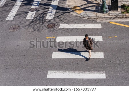 New Orleans, LA/USA - 2/7/20: Woman Crossing a Downtown Street in New Orleans #1657833997