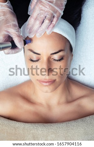 Shot of cosmetologist making mesotherapy injection with dermapen on face for rejuvenation on the spa center. Royalty-Free Stock Photo #1657904116