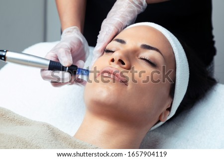 Shot of cosmetologist making mesotherapy injection with dermapen on face for rejuvenation on the spa center. Royalty-Free Stock Photo #1657904119