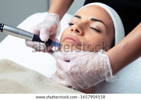 Shot of cosmetologist making mesotherapy injection with dermapen on face for rejuvenation on the spa center. Royalty-Free Stock Photo #1657904158