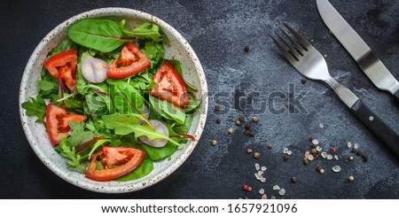 healthy salad tomato, mix leaves, onions and other ingredients, vegan, keto or paleo menu concept. top food background. copy space #1657921096