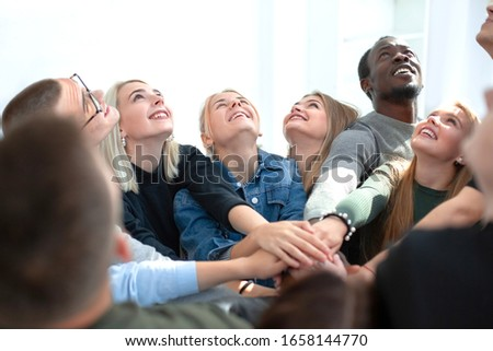 close up. a group of young people joining their palms in a pile #1658144770