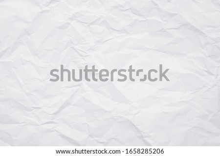 Texture of white crumpled paper for background. Royalty-Free Stock Photo #1658285206