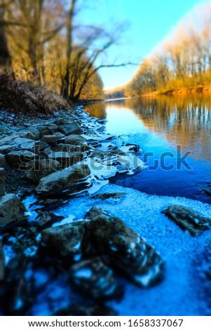 Frozen shore of the river Sieg just before the melting sunshine arives. #1658337067