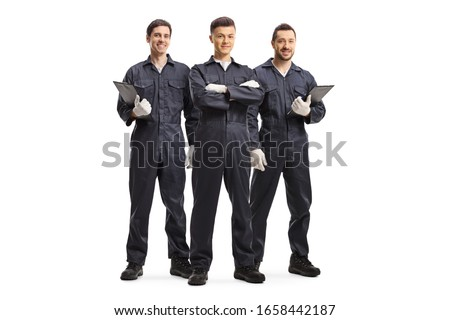 Full length portrait of three mechanic workers in uniforms isolated on white background #1658442187