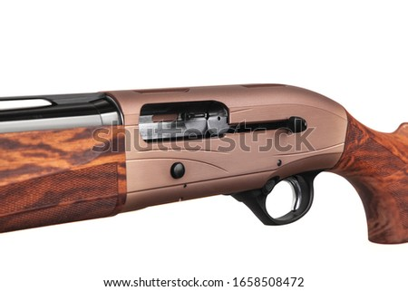 Left-handed shotgun. Hunting semi-automatic shotgun with a wooden butt and forearm isolated on white background. Convenient weapons for hunting and sports.Close-up shotgun open bolt. #1658508472