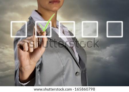 business woman making a mark, making choice #165860798