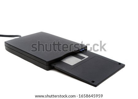 """A 3.5"""" floppy disk and drive isolated on a white background #1658645959"""