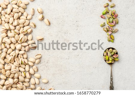 Organic pistachios. Pistachios in shell and cleaned nuts. Flat lay, top view, cop space. #1658770279