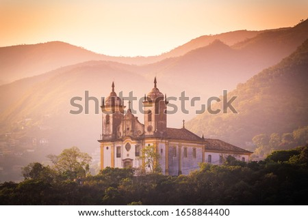 A church at Ouro Preto, Minas Gerais, Brazil. Ouro Preto is former capital of the state of Minas Gerais, Brazil. This city used to be a very rich city from gold mining. Locals said the ornaments of th #1658844400