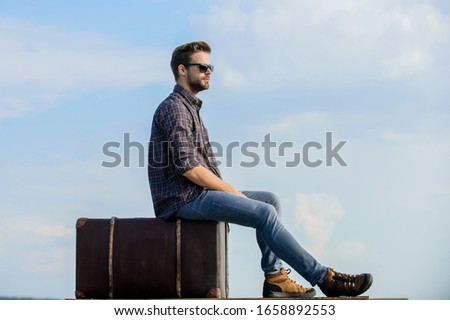 Handsome guy traveler. Guy outdoors with vintage suitcase. Luggage concept. Travel with luggage. Travel blogger. Vacation time. Travel agency. Man sit on suitcase before journey. Business trip. #1658892553