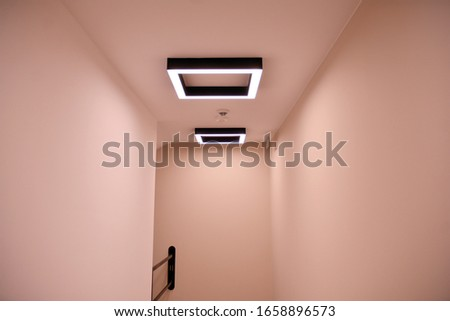 Modern lighting in the hallway of a modern building.Modern flat design. Modern building design.   #1658896573