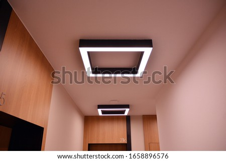Modern lighting in the hallway of a modern building.Modern flat design. Modern building design.   #1658896576