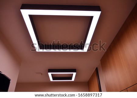 Modern lighting in the hallway of a modern building.Modern flat design. Modern building design.   #1658897317