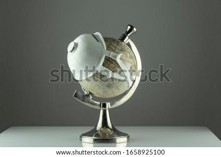 world Corona virus attack concept. world/earth put mask to fight against Corona virus. Concept of fight against virus, danger and public health risk disease.Many Virus attack #1658925100