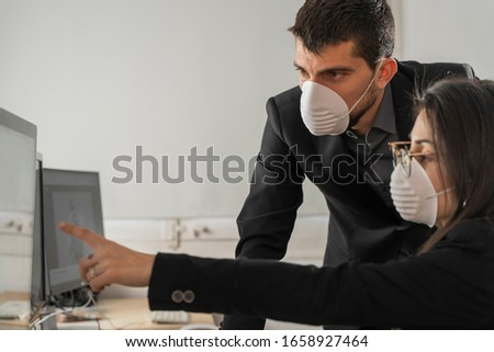 Coronavirus office workers with mask for corona virus. Business workers wear masks to protect and take care of their health. Office working with computer. Working from home.  #1658927464