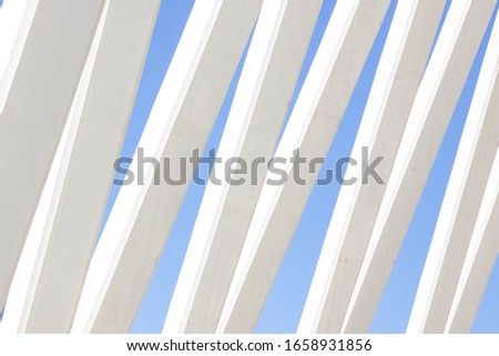 Detail of a modern building in white. Architecture concept columns and blue sky #1658931856