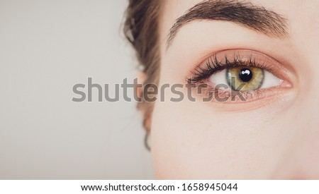 beautiful close-up shot of woman eye Royalty-Free Stock Photo #1658945044