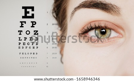 eye doctor test concept with eye test chart Royalty-Free Stock Photo #1658946346