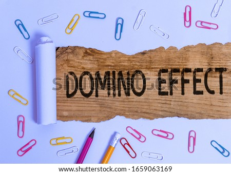 Text sign showing Domino Effect. Conceptual photo Chain reaction that causing other similar events to happen. #1659063169