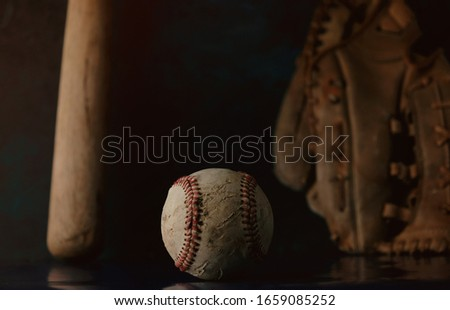 Baseball equipment with reflection on black background for vintage sport concept and moody style. Royalty-Free Stock Photo #1659085252