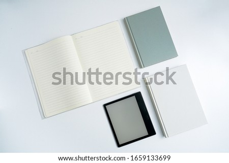 ebook and books on white desktop.Books and open notebooks on a white background #1659133699