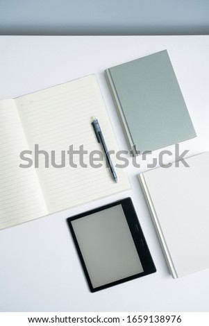 ebook and books on white desktop.Books and open notebooks on white background. #1659138976