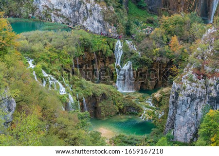 Waterfalls and streams in Plitvice Lakes National Park in autumn, Croatia #1659167218