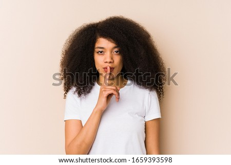 Young african american woman keeping a secret or asking for silence. #1659393598