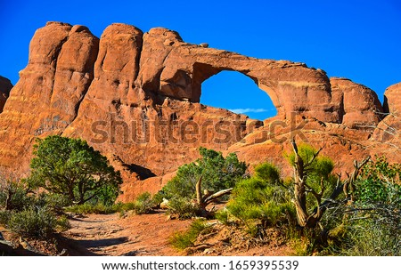 Red rock canyon sandstones view. Red rock canyon arch. Arch in red rock canyon. Red rock canyon arch Royalty-Free Stock Photo #1659395539