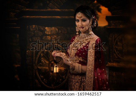 Young Indian Woman in Bridal wear and make-up Royalty-Free Stock Photo #1659462517