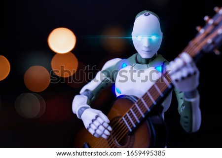 toy model robot playing getar in studio