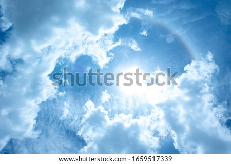Blue sky and corona natural white clouds. Sun halo and circular rainbow landscape- Image