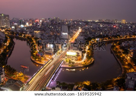 SAIGON, VIETNAM - FEB 02, 2020: Aerial sunset view of houses Center of Ho Chi Minh city on NHIEU LOC canal #1659535942