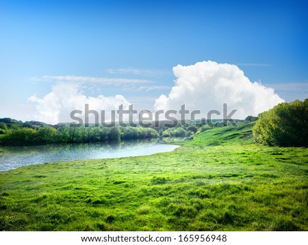 River and the field on a sunny summer day #165956948