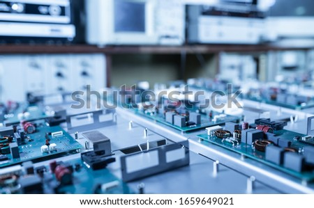 Microcircuits and components lie on metal plates during the production of super modern military computers and spy equipment. Concept of a secret military factory #1659649021