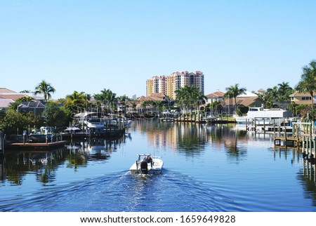 Boating along canal in Cape Coral Florida Royalty-Free Stock Photo #1659649828