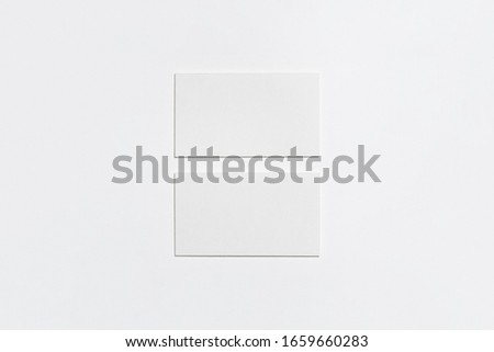 Horizontal Business Cards Mock-up on white background.Paper texture.High resolution photo.Top view