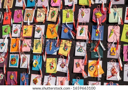 "Sibiu city, Romania - February 29, 2020. Big bazar of martenitsa on Balcescu street in city of Sibiu. Symbols of spring, romanian ""martisor"", ""1 martie"" symbol. #1659663100"