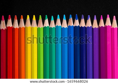 close up macro shot of colorful pencils on  black background #1659668026