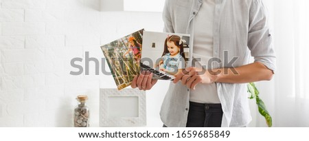 man holds canvas in the interior