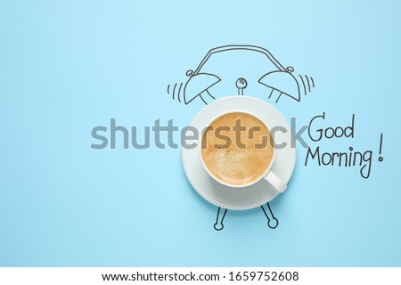 Composition with Good Morning wish and aromatic coffee on light blue background, top view. Space for text Royalty-Free Stock Photo #1659752608