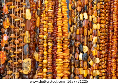 Beautiful amber jewellery for sale in Gdansk, Poland. Amber jewellery close up background #1659781225
